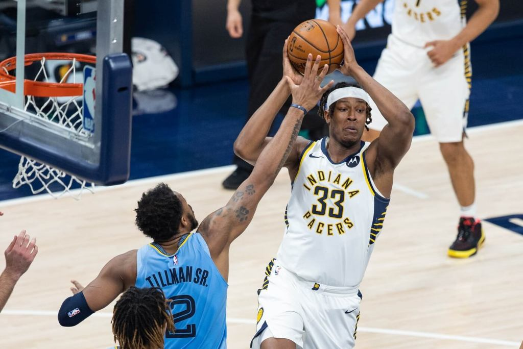 Indiana Pacers center Myles Turner (33) passes the ball away from Memphis Grizzlies forward Xavier Tillman (2) in the third quarter at Bankers Life Fieldhouse.