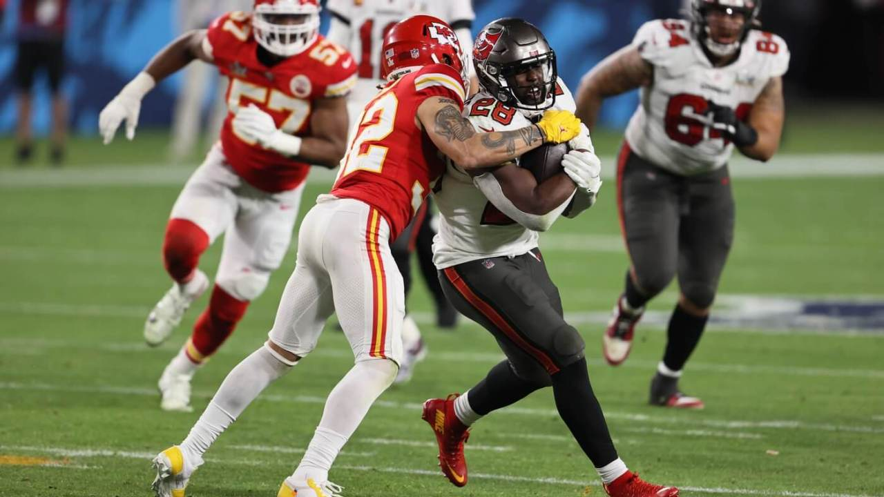 Tampa Bay Buccaneers running back Leonard Fournette (28) is tackled by Kansas City Chiefs strong safety Tyrann Mathieu (32) in the second half during Super Bowl LV at Raymond James Stadium.