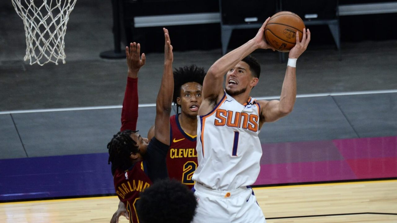 Phoenix Suns guard Devin Booker (1) shoots over Cleveland Cavaliers guard Darius Garland (10) during the second half at Phoenix Suns Arena.