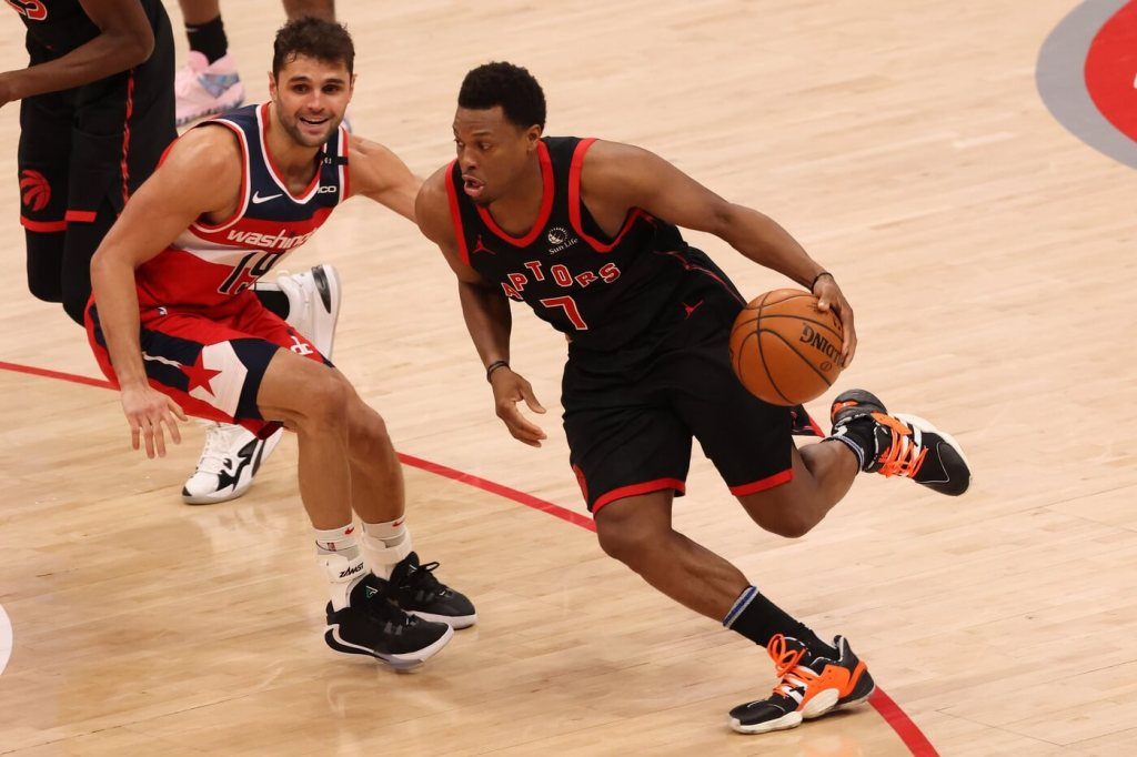 Toronto Raptors guard Kyle Lowry (7) drives to the basket as Washington Wizards guard Raul Neto (19) defends in the third quarter at Capital One Arena