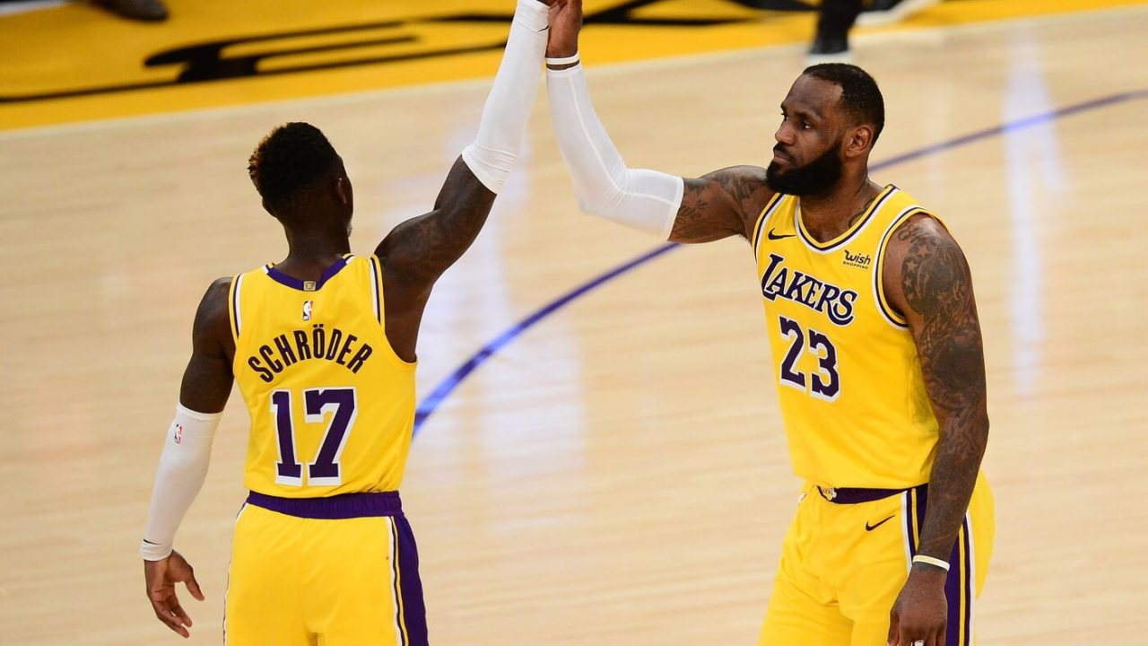 Feb 10, 2021; Los Angeles, California, USA; Los Angeles Lakers forward LeBron James (23) and guard Dennis Schroder (17) celebrate the 114-113 overtime victory against the Oklahoma City Thunder at Staples Center.