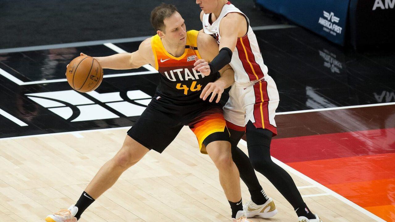 Utah Jazz forward Bojan Bogdanovic (44) dribbles the ball against Miami Heat guard Tyler Herro (14) during the second half at Vivint Smart Home Arena.