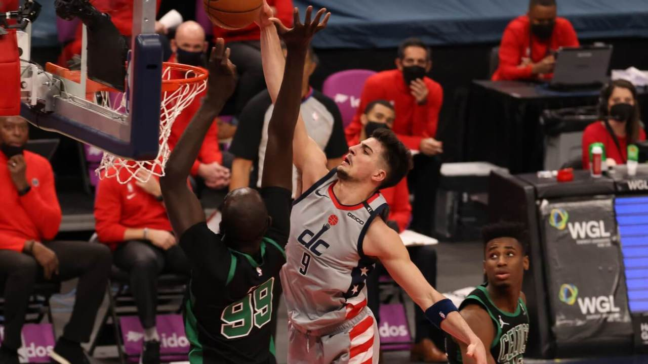 Feb 14, 2021; Washington, District of Columbia, USA; Washington Wizards forward Deni Avdija (9) is fouled while attempting to dunk the ball by Boston Celtics center Tacko Fall (99) in the fourth quarter at Capital One Arena. Mandatory Credit: Geoff Burke-USA TODAY Sports