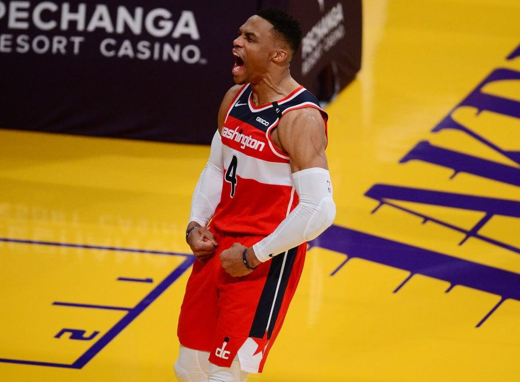 Washington Wizards guard Russell Westbrook (4) reacts after scoring a basket and drawing a foul against the Los Angeles Lakers during overtime at Staples Center