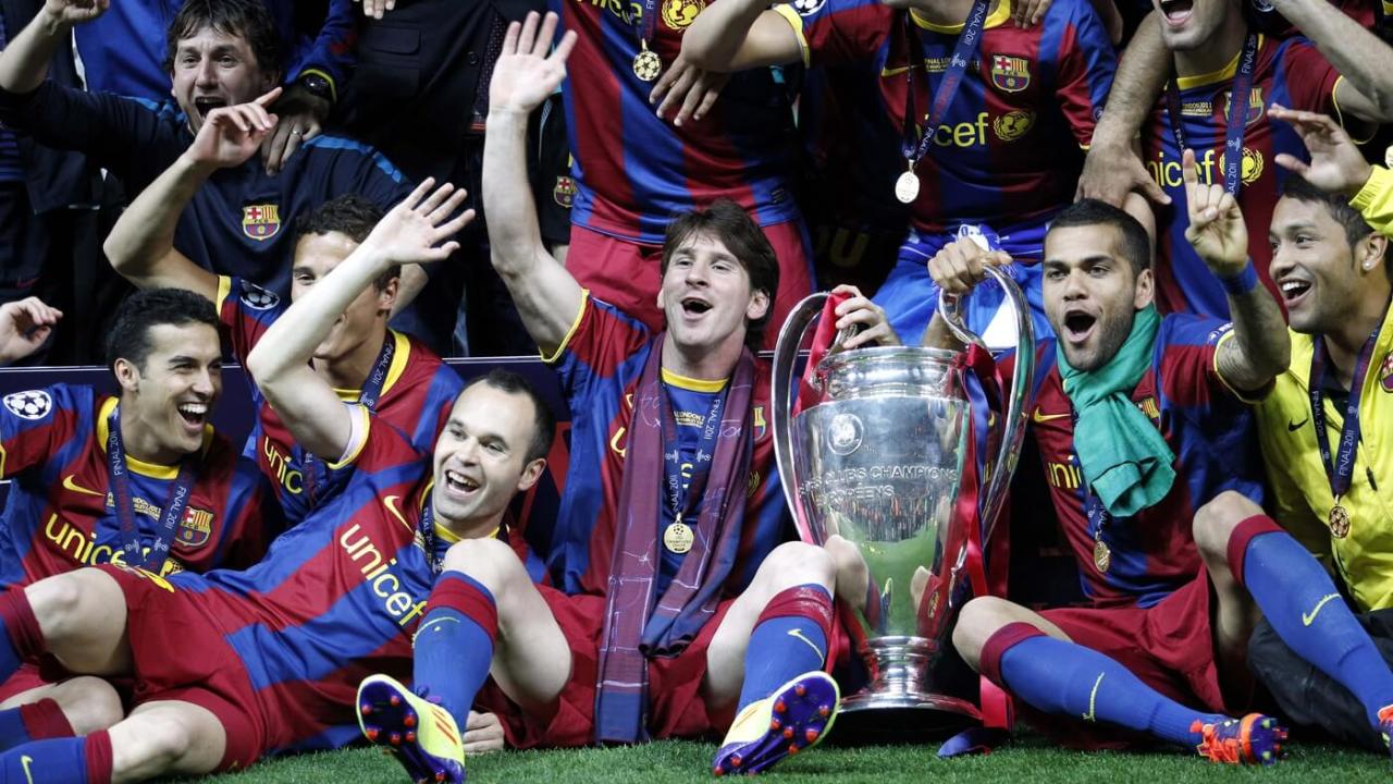 May 28, 2011; London, ENGLAND; FC Barcelona player Lionel Messi (middle) and his teammates celebrate with the championship trophy after defeating Manchester United 3-1 in the 2011 UEFA Champions League final at Wembley Stadium. Mandatory Credit: Walter Luger/GEPA via USA TODAY Sports