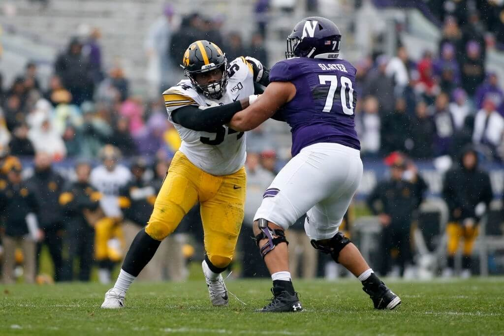 Daviyon Nixon #54 of the Iowa Hawkeyes is blocked by Rashawn Slater #70 of the Northwestern Wildcats at Ryan Field on October 26, 2019 in Evanston, Illinois.