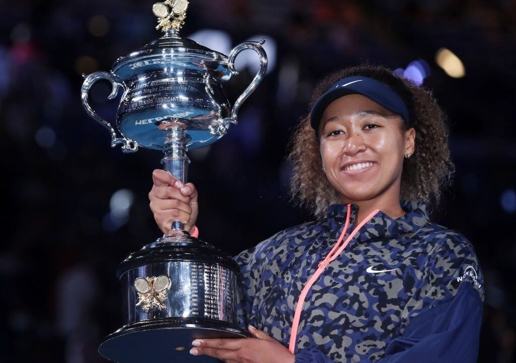 Naomi Osaka of Japan celebrates with her trophy during the awarding ceremony after women's singles final between Naomi Osaka of Japan and Jennifer Brady of the United States at Australian Open in Melbourne, Australia, Feb. 20, 2021.