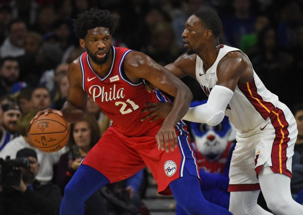 Nov 23, 2019; Philadelphia, PA, USA; Philadelphia 76ers center Joel Embiid (21) is guarded by Miami Heat center Bam Adebayo (13) at Wells Fargo Center. Mandatory Credit: Eric Hartline-USA TODAY Sports
