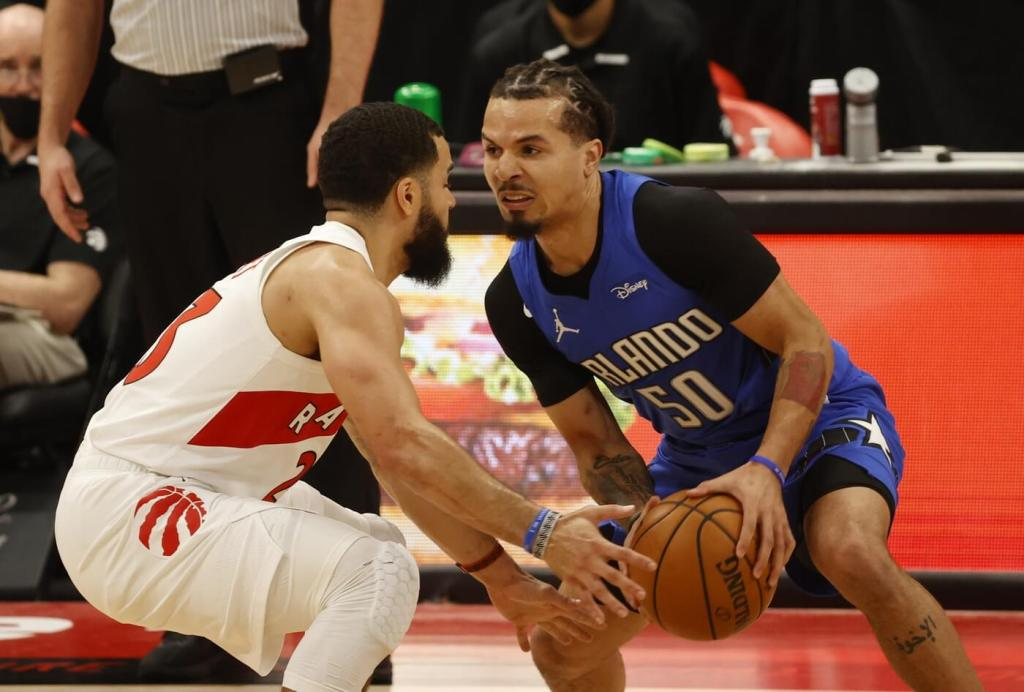 wJan 31, 2021; Tampa, Florida, USA; Orlando Magic guard Cole Anthony (50) drives to the basket as Toronto Raptors guard Fred VanVleet (23) defends during the first quarter at Amalie Arena. Mandatory Credit: Kim Klement-USA TODAY Sports