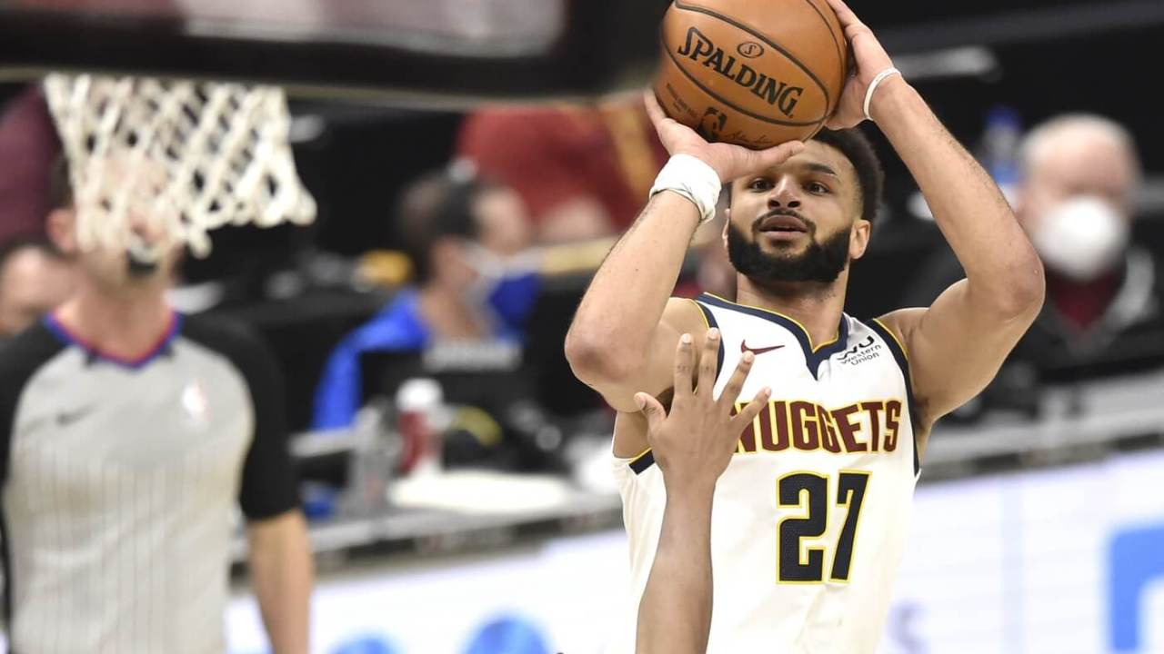 Feb 19, 2021; Cleveland, Ohio, USA; Denver Nuggets guard Jamal Murray (27) makes a basket in the fourth quarter against the Cleveland Cavaliers at Rocket Mortgage FieldHouse. Mandatory Credit: David Richard-USA TODAY Sports