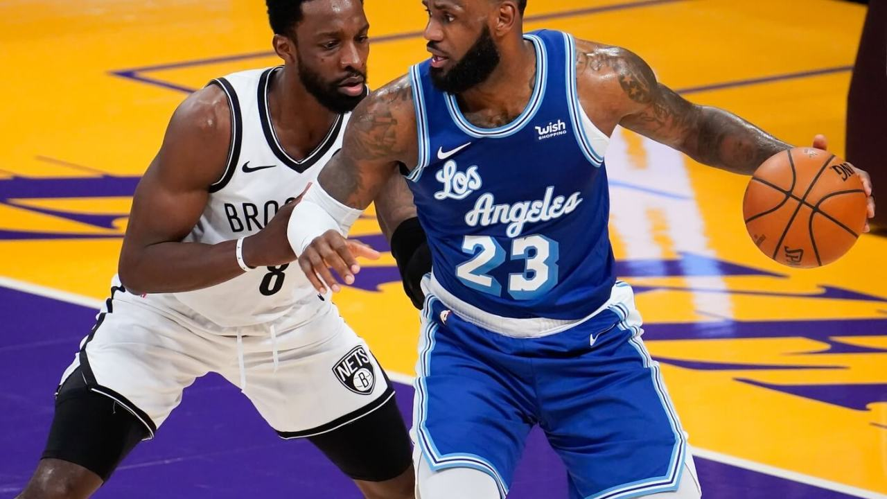 Feb 18, 2021; Los Angeles, California, USA; Los Angeles Lakers forward LeBron James (23) defended b y Brooklyn Nets forward Jeff Green (8) during the third quarter at Staples Center. Mandatory Credit: Robert Hanashiro-USA TODAY Sports