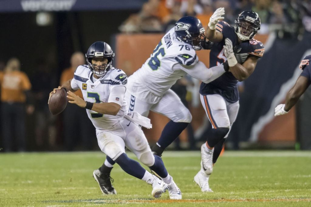 Sep 17, 2018; Chicago, IL, USA; Seattle Seahawks quarterback Russell Wilson (3) runs the ball against the Chicago Bears during the first half at Soldier Field. Mandatory Credit: Patrick Gorski-USA TODAY Sports