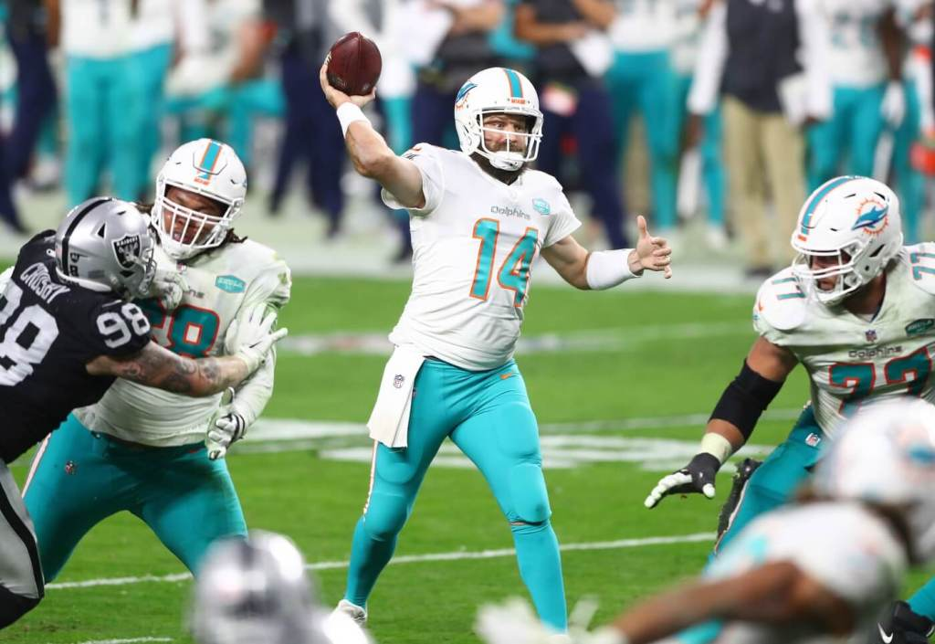 Dec 26, 2020; Paradise, Nevada, USA; Miami Dolphins quarterback Ryan Fitzpatrick (14) throws against the Las Vegas Raiders during the second half at Allegiant Stadium. Mandatory Credit: Mark J. Rebilas-USA TODAY Sports
