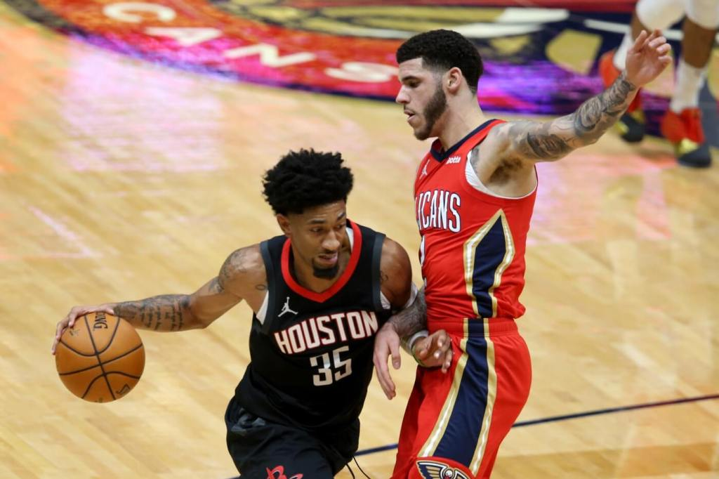 Houston Rockets center Christian Wood (35) is defended by New Orleans Pelicans guard Lonzo Ball (2) in the first quarter at the Smoothie King Center.