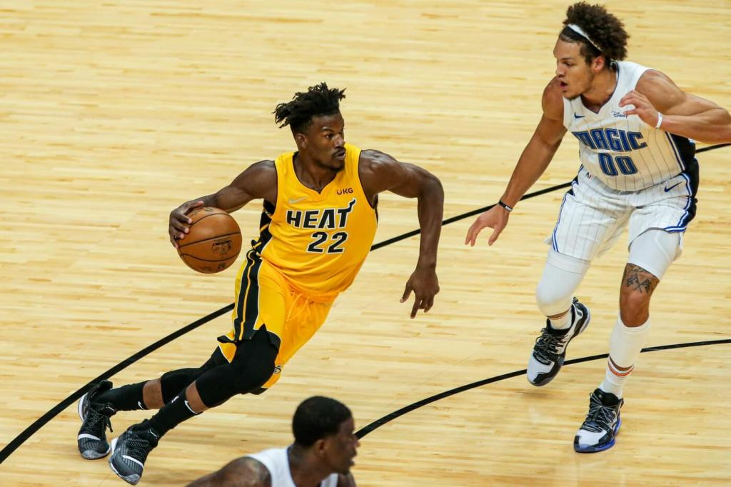 Miami Heat forward Jimmy Butler (22) controls the basketball against Orlando Magic forward Aaron Gordon (00) during the first quarter at American Airlines Arena.