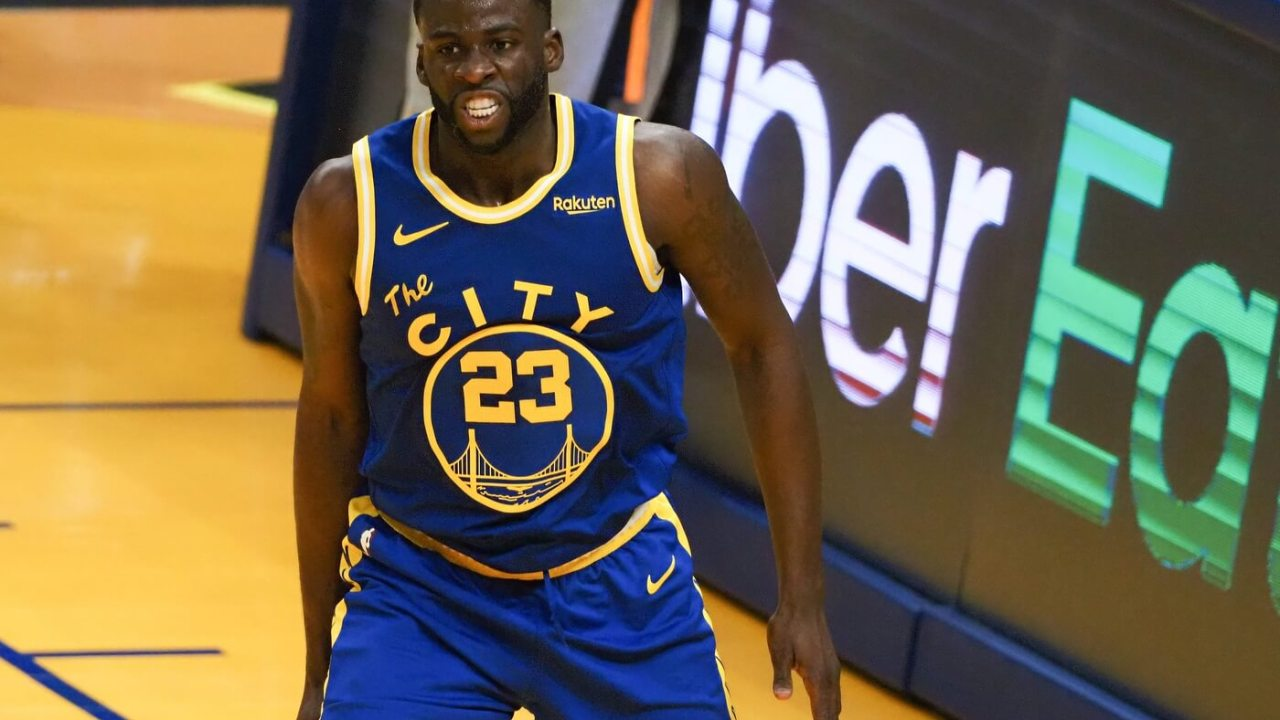 Golden State Warriors forward Draymond Green (23) reacts after a dunk against the Utah Jazz during the second quarter at Chase Center.