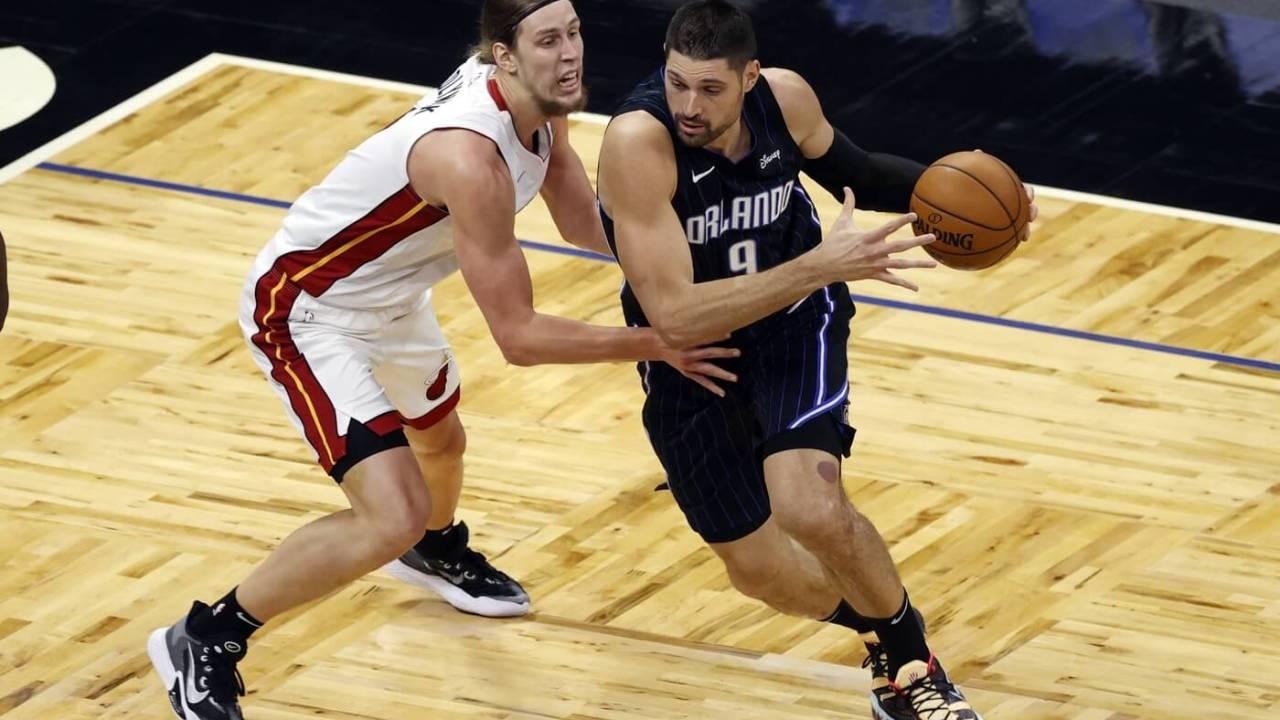 Mar 14, 2021; Orlando, Florida, USA; Orlando Magic center Nikola Vucevic (9) drives to the basket as Miami Heat forward Kelly Olynyk (9) defends during the first quarter at Amway Center. Mandatory Credit: Kim Klement-USA TODAY Sports