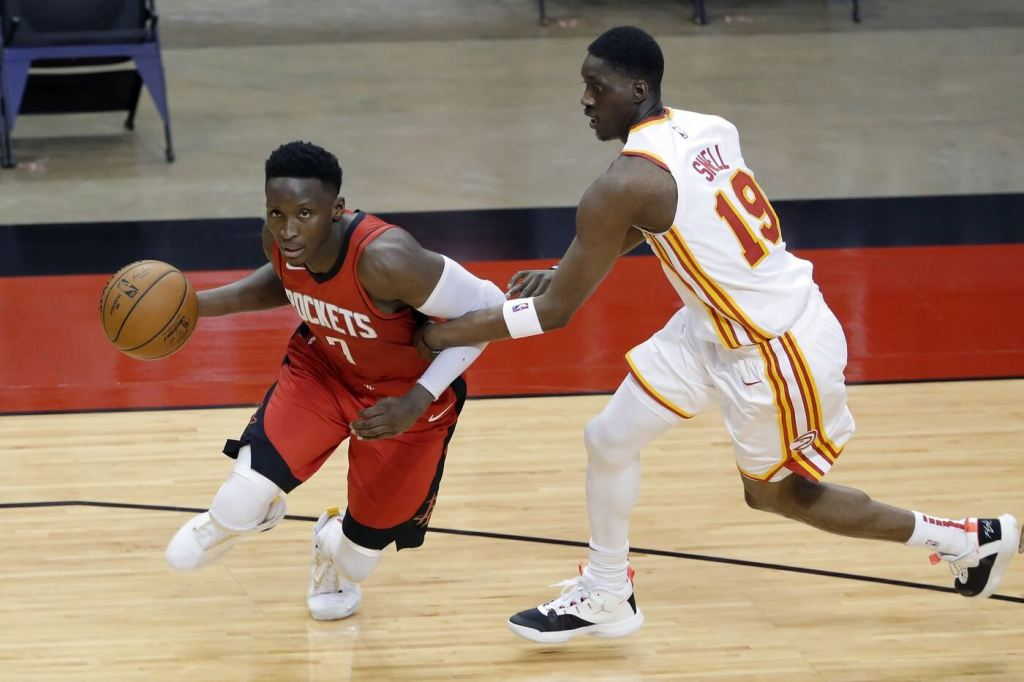 Houston Rockets guard Victor Oladipo (7) is fouled as he drives around Atlanta Hawks guard Tony Snell (19) during the second half at Toyota Center.