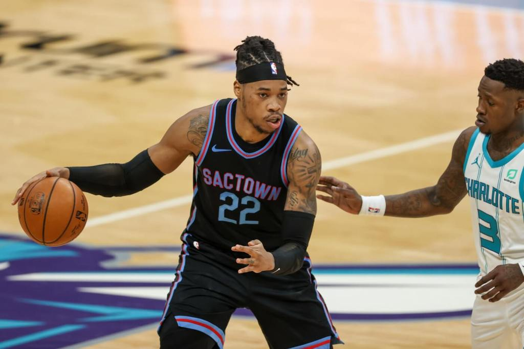 Mar 15, 2021; Charlotte, North Carolina, USA; Sacramento Kings center Richaun Holmes (22) brings the ball up court against Charlotte Hornets guard Terry Rozier (3) during the second half at Spectrum Center. The Charlotte Hornets won 122-116. Mandatory Credit: Nell Redmond-USA TODAY Sports