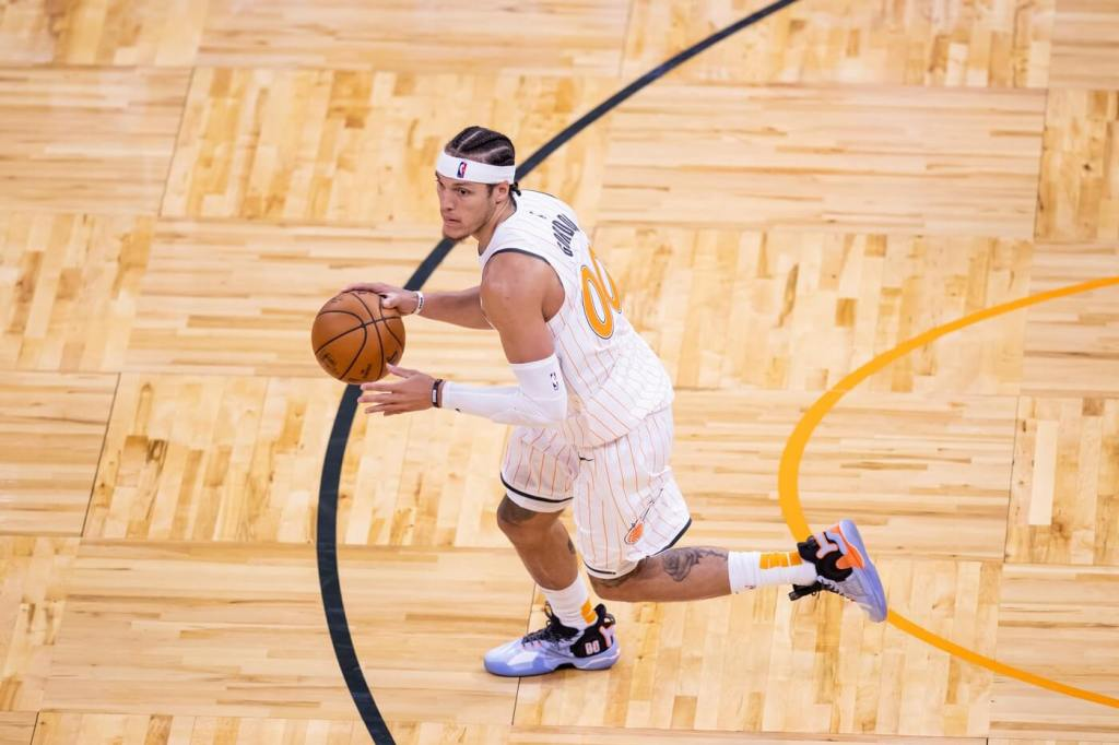 Orlando Magic forward Aaron Gordon (00) dribbles during the fourth quarter of a game between the Phoenix Suns and the Orlando Magic at Amway Center.