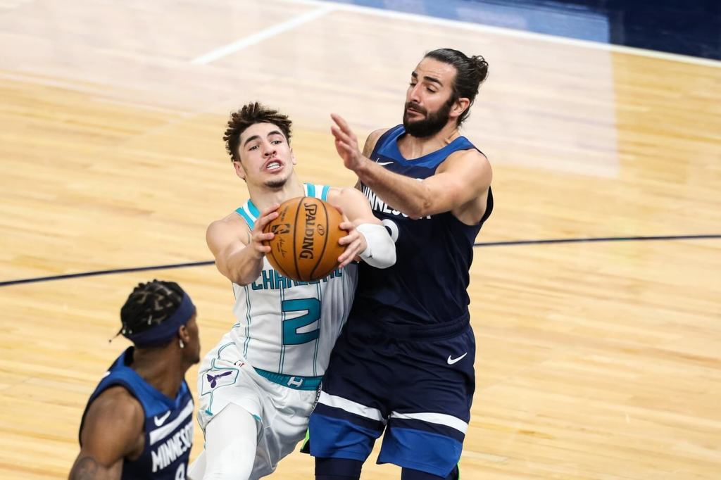 Mar 3, 2021; Minneapolis, Minnesota, USA; Charlotte Hornets guard LaMelo Ball (2) drives to the basket while Minnesota Timberwolves guard Ricky Rubio (9) defends in the third quarter at Target Center. Mandatory Credit: David Berding-USA TODAY Sports