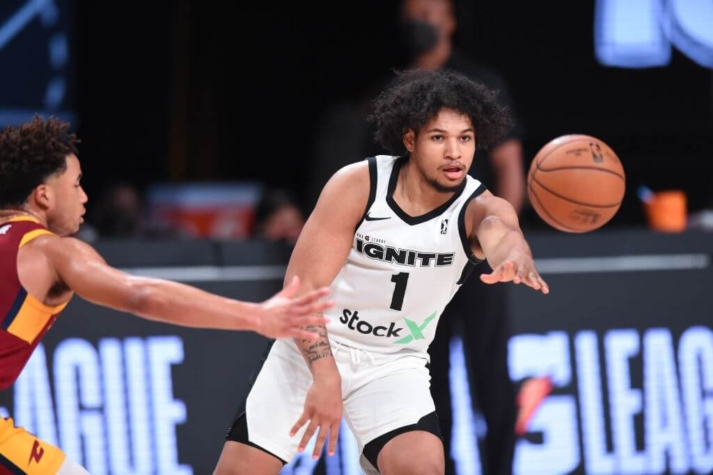 Daishen Nix #1 of Team Ignite passes the ball against the Canton Charge on February 27, 2021 at AdventHealth Arena in Orlando, Florida