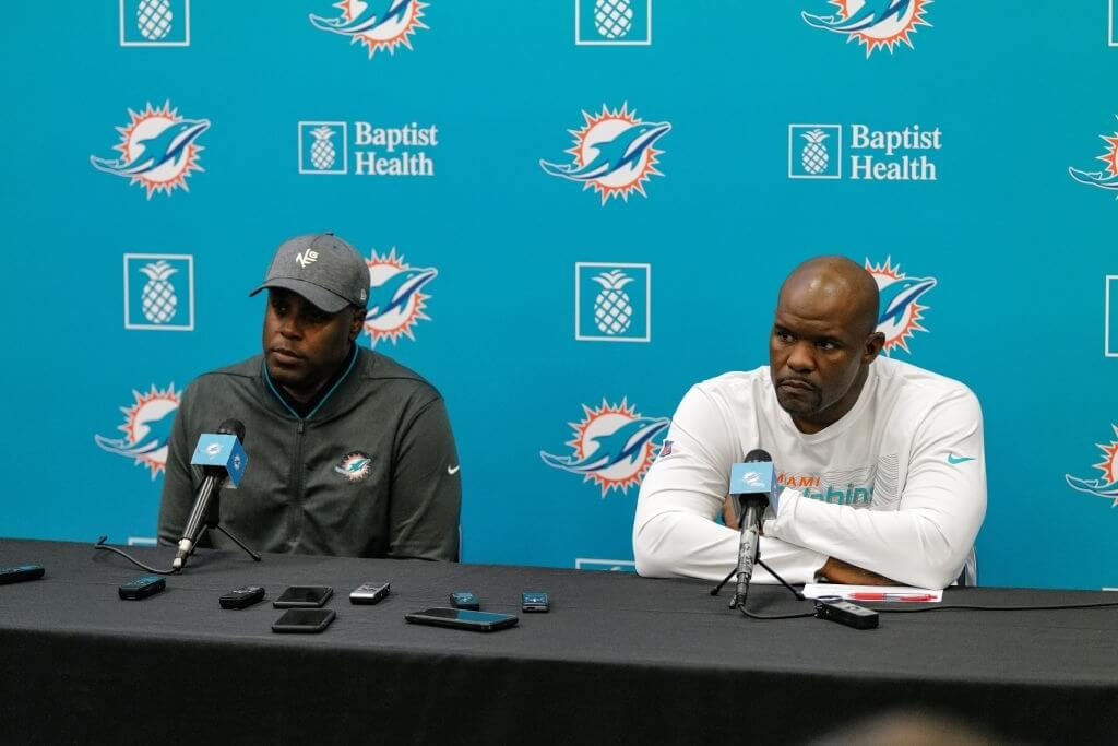 General Manager Chris Grier and Head Coach Brian Flores of the Miami Dolphins answers questions from the media during a season ending press conference at Baptist Health Training Facility at Nova Southern University on December 30, 2019 in Davie, Florida