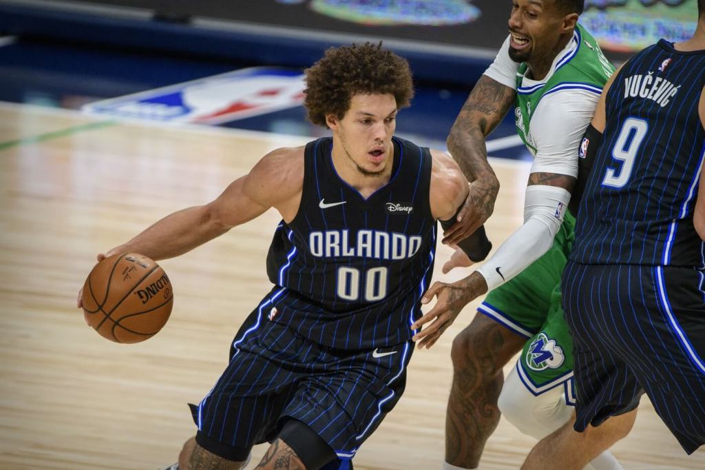 Jan 9, 2021; Dallas, Texas, USA; Orlando Magic forward Aaron Gordon (00) in action during the game between the Dallas Mavericks and the Orlando Magic at the American Airlines Center. Mandatory Credit: Jerome Miron-USA TODAY Sports