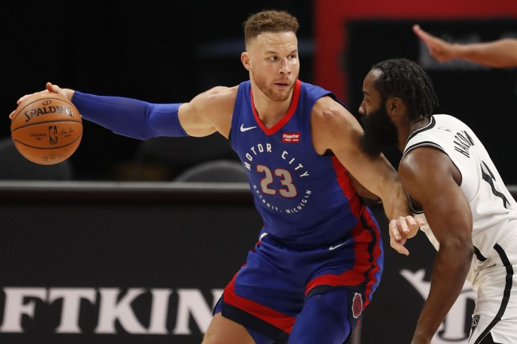 Feb 9, 2021; Detroit, Michigan, USA; Detroit Pistons forward Blake Griffin (23) controls the ball while defended by Brooklyn Nets guard James Harden (R) during the first quarter at Little Caesars Arena. Mandatory Credit: Raj Mehta-USA TODAY Sports