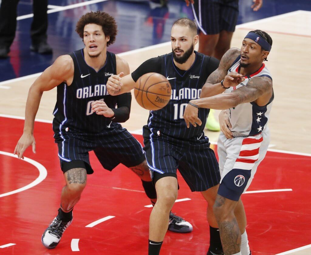 Dec 27, 2020; Washington, District of Columbia, USA; Washington Wizards guard Bradley Beal (R) passes the ball in front of Orlando Magic forward Aaron Gordon (L) and guard Evan Fournier (C) in the third quarter of their NBA game at the Capitol One Arena in Washington, DC, USA, 27 December 2020. . Mandatory Credit: Shawn Thew/Pool Photo viaUSA TODAY Sports