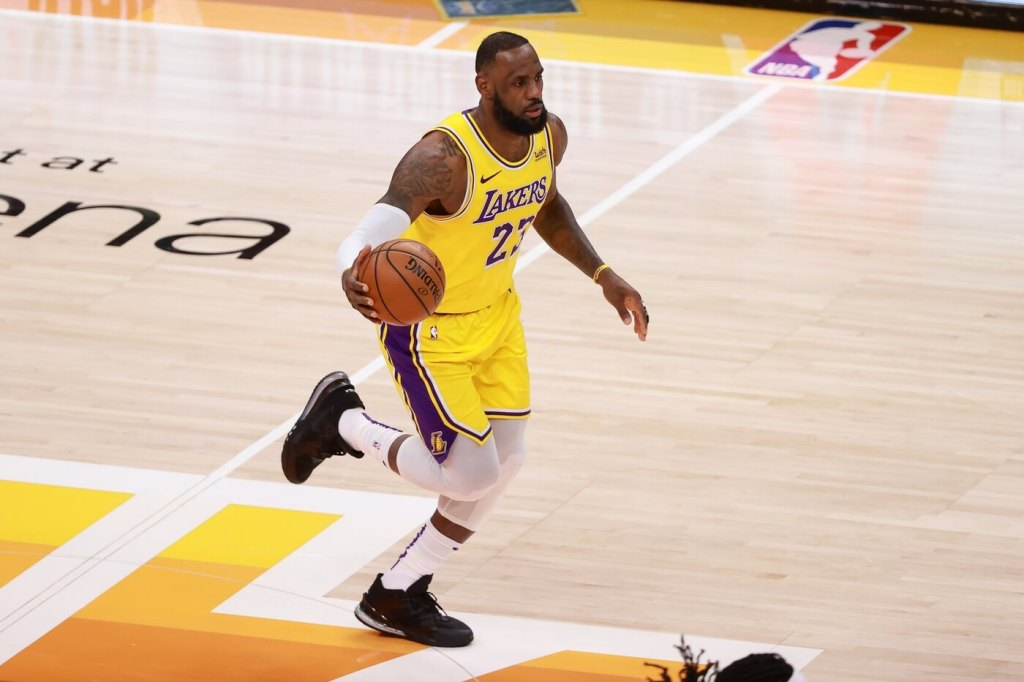Feb 24, 2021; Salt Lake City, Utah, USA; Los Angeles Lakers forward LeBron James (23) brings the ball up the court against the Utah Jazz during the first quarter at Vivint Smart Home Arena. Mandatory Credit: Chris Nicoll-USA TODAY Sports