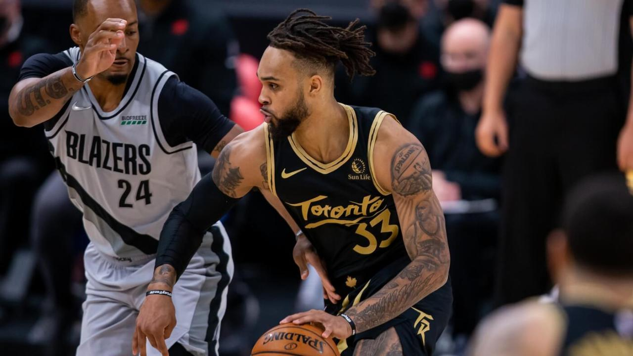 Mar 28, 2021; Tampa, Florida, USA; Toronto Raptors guard Gary Trent Jr. (33) drives past Portland Trail Blazers forward Norman Powell (24) during the first quarter at Amalie Arena. Mandatory Credit: Mary Holt-USA TODAY Sports