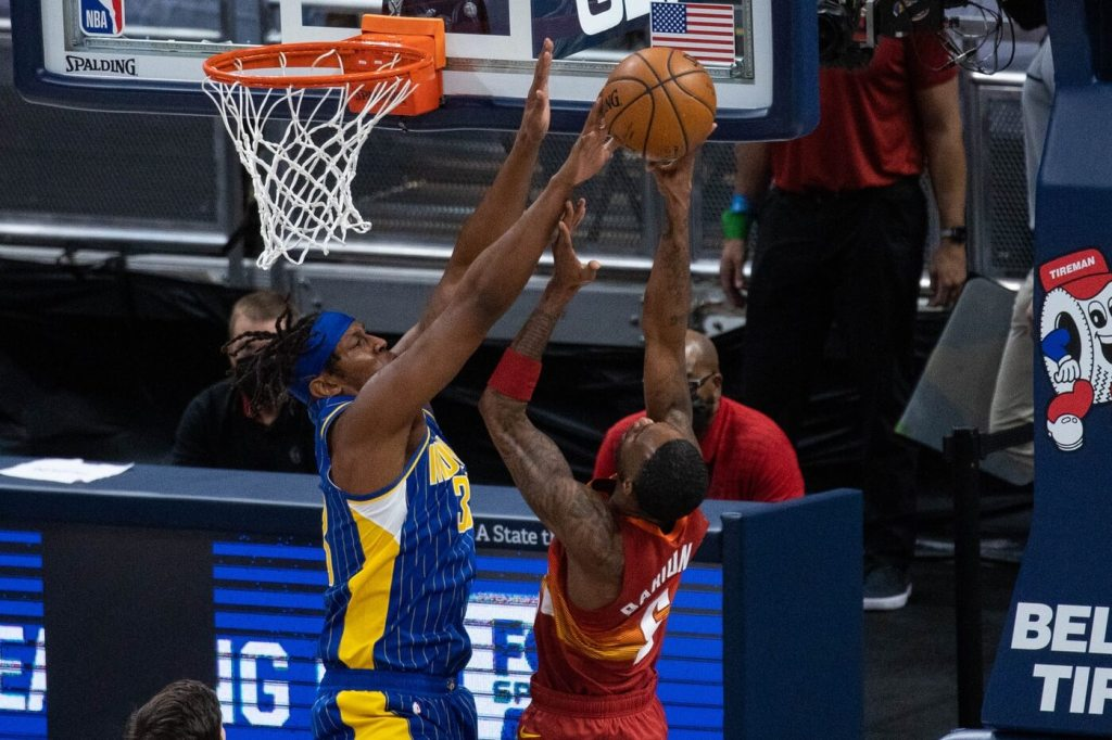 Mar 4, 2021; Indianapolis, Indiana, USA; Indiana Pacers center Myles Turner (33) blocks the shot of Denver Nuggets forward Will Barton (5) in the first quarter at Bankers Life Fieldhouse. Mandatory Credit: Trevor Ruszkowski-USA TODAY Sports