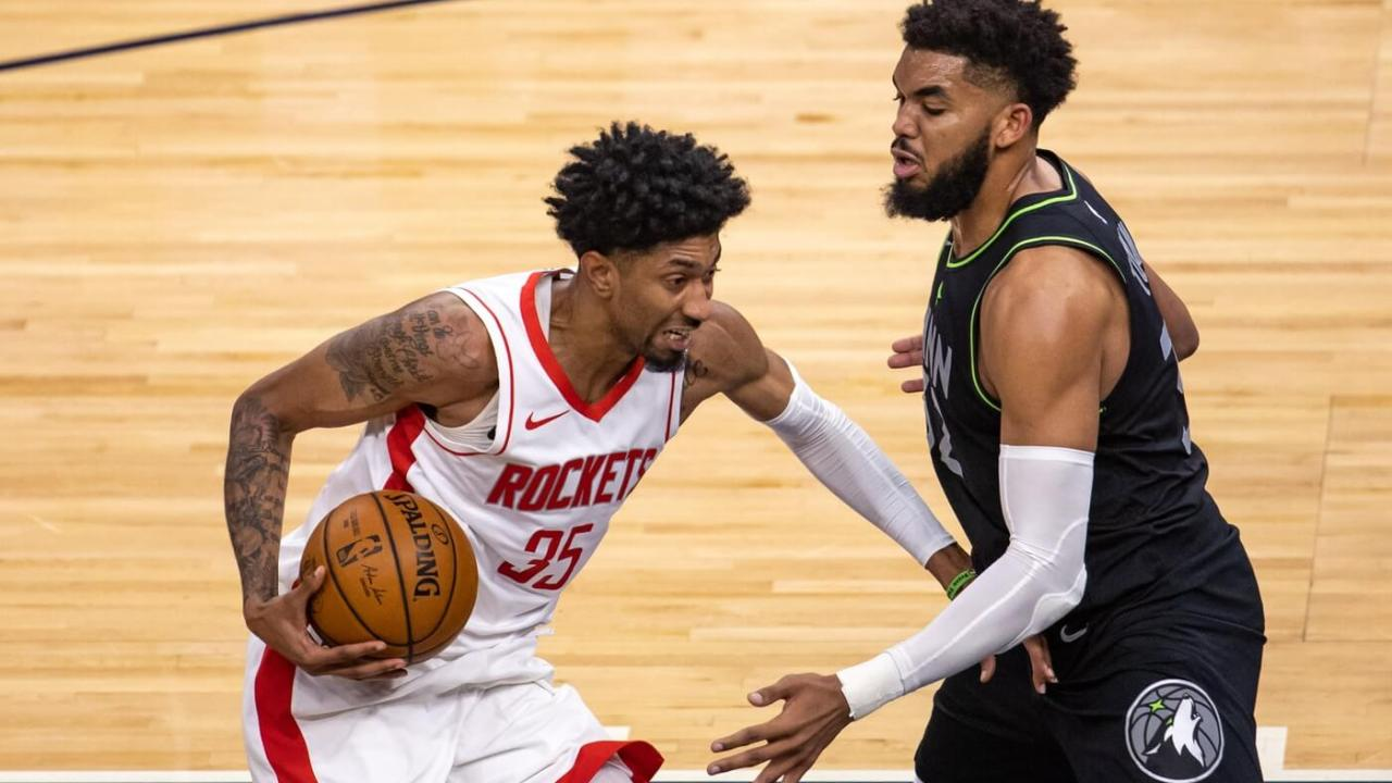 Mar 26, 2021; Minneapolis, Minnesota, USA; Houston Rockets center Christian Wood (35) drives to the basket as Minnesota Timberwolves center Karl-Anthony Towns (32) plays defense in the second half at Target Center. Mandatory Credit: Jesse Johnson-USA TODAY Sports