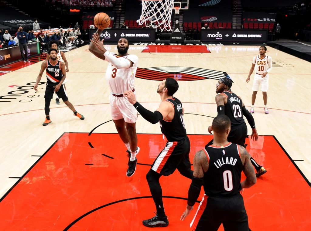 Feb 12, 2021; Portland, Oregon, USA; Cleveland Cavaliers center Andre Drummond (3) shoots the ball over Portland Trail Blazers center Enes Kanter (11) during the second half of the game at Moda Center. Mandatory Credit: Steve Dykes-USA TODAY Sports