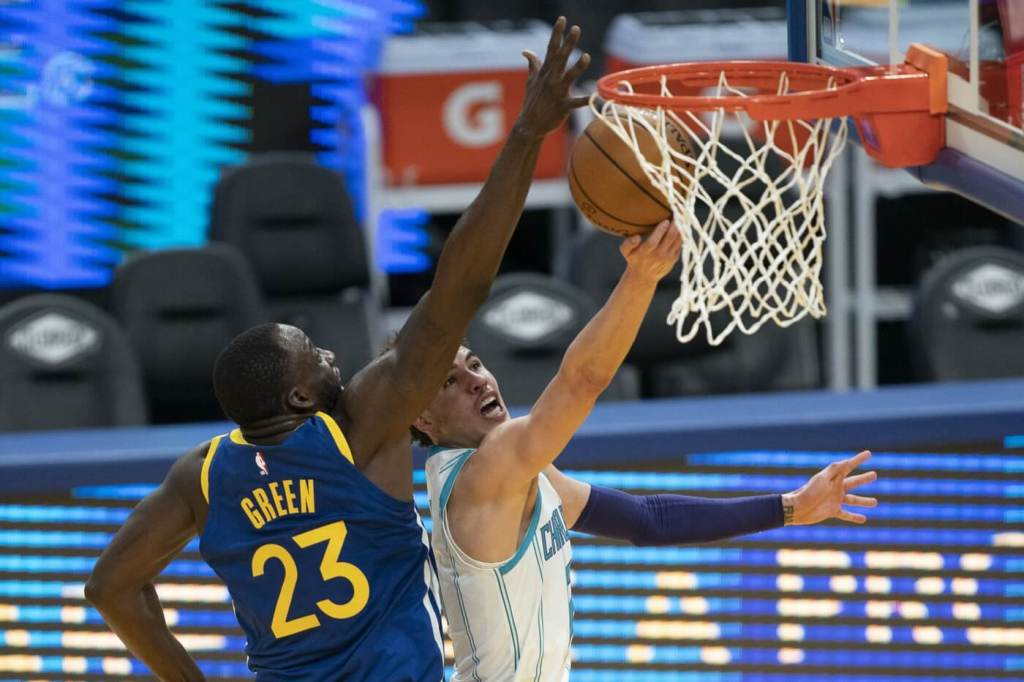 February 26, 2021; San Francisco, California, USA; Charlotte Hornets guard LaMelo Ball (2) shoots the basketball against Golden State Warriors forward Draymond Green (23) during the second quarter at Chase Center. Mandatory Credit: Kyle Terada-USA TODAY Sports