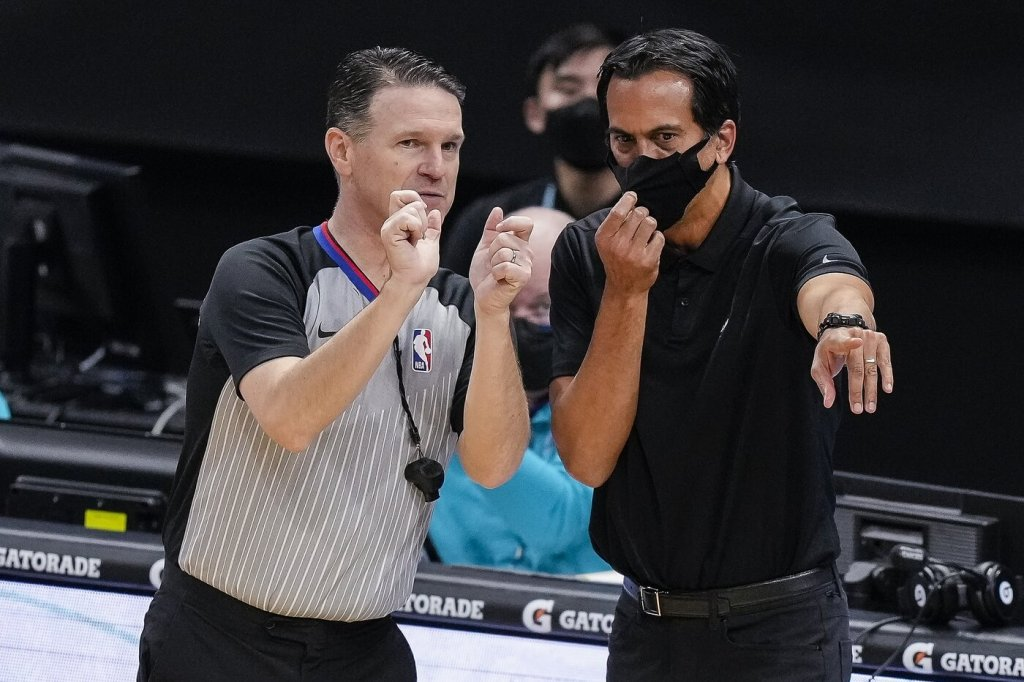 Mar 26, 2021; Charlotte, North Carolina, USA; Miami Heat head coach Erik Spoelstra argues a call with referee Pat Fraher (26) during the second half against the Charlotte Hornets at Spectrum Center. Mandatory Credit: Jim Dedmon-USA TODAY Sports