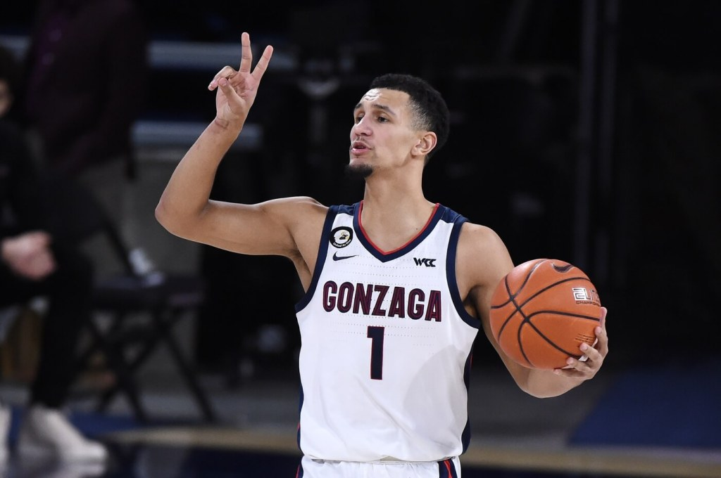 Feb 25, 2021; Spokane, Washington, USA; Gonzaga Bulldogs guard Jalen Suggs (1) relays the play during a game against the Santa Clara Broncos in the second half at McCarthey Athletic Center. Gonzaga won 89-75. Mandatory Credit: James Snook-USA TODAY Sports