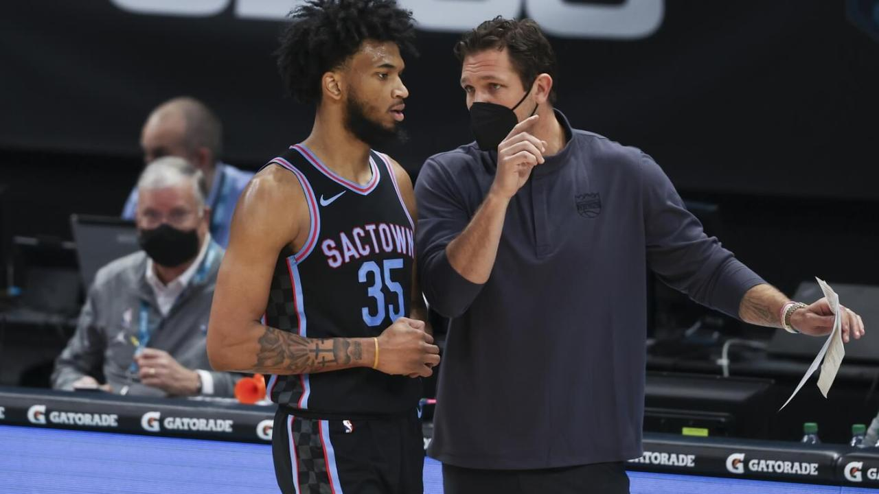 Mar 15, 2021; Charlotte, North Carolina, USA; Sacramento Kings coach Luke Walton talks to Sacramento Kings forward Marvin Bagley III (35) as they play against the Charlotte Hornets during the second quarter at Spectrum Center. Mandatory Credit: Nell Redmond-USA TODAY Sports