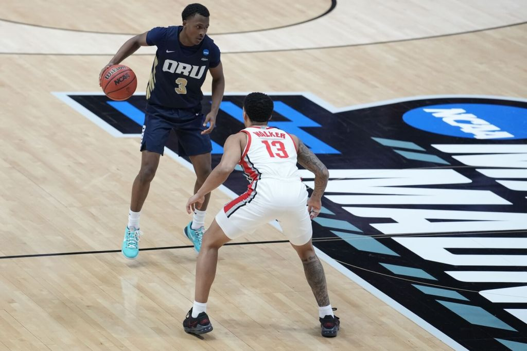Mar 19, 2021; West Lafayette, Indiana, USA; Oral Roberts Golden Eagles guard Max Abmas (3) brings the ball up court against Ohio State Buckeyes guard CJ Walker (13) during the second half in the first round of the 2021 NCAA Tournament at Mackey Arena. Mandatory Credit: Mike Dinovo-USA TODAY Sports
