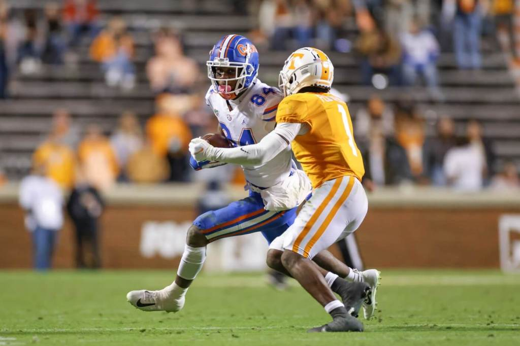 Dec 5, 2020; Knoxville, Tennessee, USA; Florida Gators tight end Kyle Pitts (84) runs with the ball against Tennessee Volunteers defensive back Trevon Flowers (1) during the second half at Neyland Stadium. Mandatory Credit: Randy Sartin-USA TODAY Sports