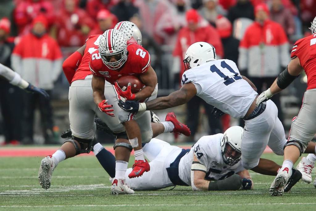 Nov 23, 2019; Columbus, OH, USA; Ohio State Buckeyes running back J.K. Dobbins (2) runs for the first down as Penn State Nittany Lions linebacker Micah Parsons (11) defends during the fourth quarter at Ohio Stadium. Mandatory Credit: Joe Maiorana-USA TODAY Sports