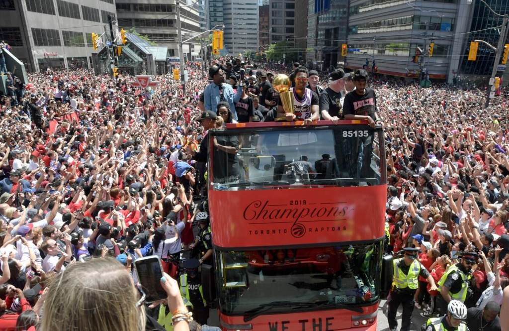 Jun 17, 2019; Toronto, Ontario, Canada; Toronto Raptors players show off the Larry O'Brien trophy to fans during a parade through downtown Toronto to celebrate their NBA title. Mandatory Credit: Dan Hamilton-USA TODAY Sports