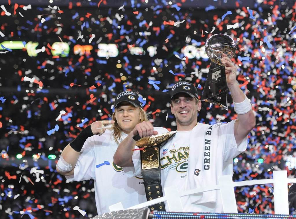 Green Bay Packers linebacker Clay Matthews, left, points to Super Bowl MVP Aaron Rodgers after giving him a championship belt after the win against the Pittsburgh Steelers during Super Bowl XLV at Cowboys Stadium in Arlington, Texas on Feb. 6, 2011. Super Bowl Xlv