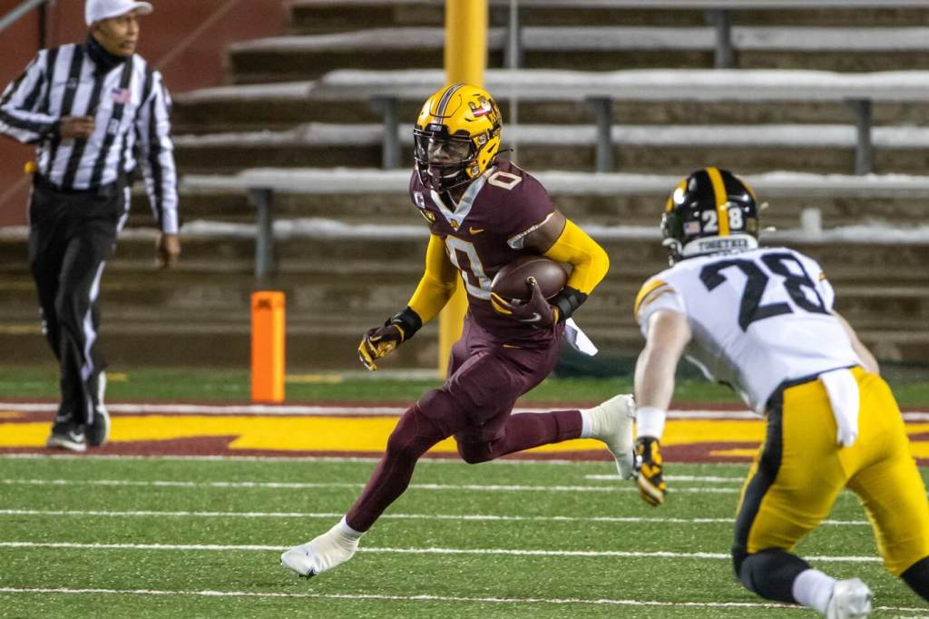 Minnesota Golden Gophers wide receiver Rashod Bateman (0) rushes with the ball after making a catch in the first half against the Iowa Hawkeyes at TCF Bank Stadium.