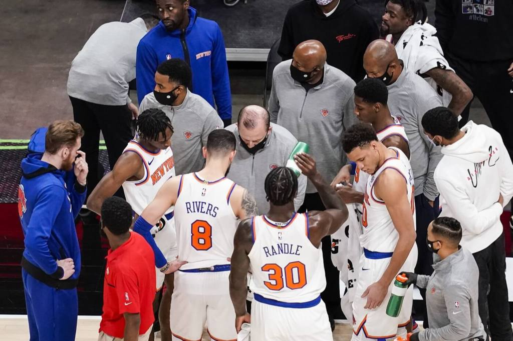New York Knicks head coach Tom Thibodeau talks to his players during a time out in the second half against the Atlanta Hawks at State Farm Arena.