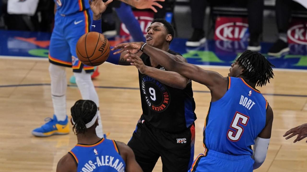 Jan 8, 2021; New York, New York, USA; Oklahoma City Thunder's Luguentz Dort (5), right, knocks the ball away from New York Knicks' RJ Barrett, center, during the second half of an NBA basketball game, Friday, Jan. 8, 2021, in New York at Madison Square Garden. Mandatory Credit: Seth Wenig/POOL PHOTOS-USA TODAY Sports