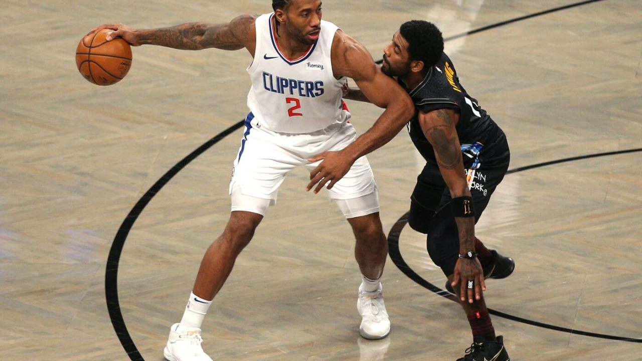 Feb 2, 2021; Brooklyn, New York, USA; Los Angeles Clippers small forward Kawhi Leonard (2) controls the ball against Brooklyn Nets point guard Kyrie Irving (11) during the first quarter at Barclays Center. Mandatory Credit: Brad Penner-USA TODAY Sports