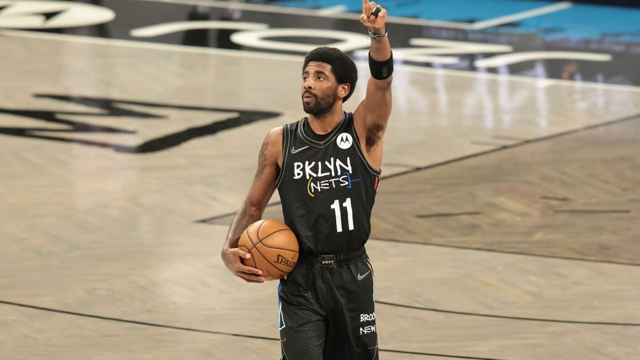Apr 5, 2021; Brooklyn, New York, USA; Brooklyn Nets guard Kyrie Irving (11) gestures to fans before a game against the New York Knicks at Barclays Center. Mandatory Credit: Vincent Carchietta-USA TODAY Sports
