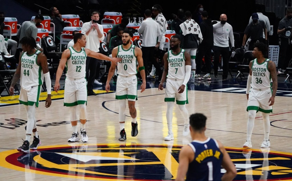 Apr 11, 2021; Denver, Colorado, USA; Boston Celtics center Robert Williams III (44) and forward Grant Williams (12) and forward Jayson Tatum (0) and guard Jaylen Brown (7) and guard Marcus Smart (36) during the fourth quarter against the Denver Nuggets at Ball Arena. Mandatory Credit: Ron Chenoy-USA TODAY Sports